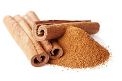 Closeup of cinnamon sticks and powder of ground cinnamon on white Stock Photography
