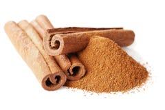 Closeup of cinnamon sticks and powder of ground cinnamon on white Stock Photography
