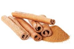 Closeup of cinnamon sticks and powder of ground cinnamon on white Stock Image