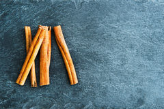 Closeup on cinnamon sticks on stone substrate Stock Photography