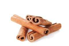 Closeup of cinnamon sticks on white Royalty Free Stock Photos