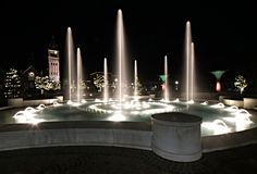 A closeup of a city fountain at night. royalty free stock image