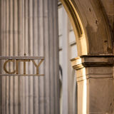 Closeup  Of A City Sign. Detail Of Merchant City Sign Glasgow With Classic Architectural Details Royalty Free Stock Photography