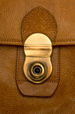 Closeup of clasp on  battered, leather  briefcase Stock Images