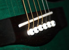 A closeup of a classic guitar. Royalty Free Stock Image