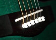 A closeup of a classic guitar. A closeup of a green classic guitar Royalty Free Stock Image
