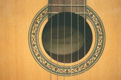 Closeup classic guitar. Classic guitar sound hole background Royalty Free Stock Image