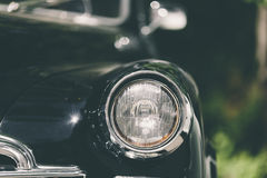 Closeup of classic luxury black car. Royalty Free Stock Images