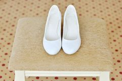 Closeup of a classic pair of white womens shoes royalty free stock photo