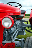 Closeup 1956 Classic Red Farm Tractor. Closeup of a classic 1956 red farm Tractor that has been restored in like new condition Royalty Free Stock Images