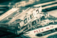 Closeup of classic stack of audio cassettes. On old table stock images