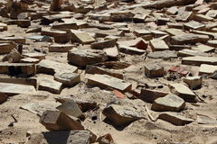 Closeup on Clay Building Brick Tiles in Sand Stock Photography