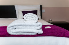 Closeup clean towels and soap in hotel room Royalty Free Stock Image