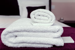 Closeup clean towels and soap in hotel room hygiene and hospitality concept.  stock images