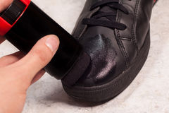 Closeup of cleaning black shoes with black paste Stock Photography