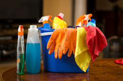 Closeup of cleaning chemicals, gloves and rags lying in plastic Royalty Free Stock Photography