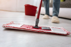 Closeup cleaning mopping floor. Closeup of human cleaning mopping floor Stock Photos