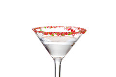 Closeup clear candy cane martini Royalty Free Stock Photography