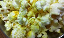 Closeup click of Popcorn. A closeup click of popcorns in a place stock photography