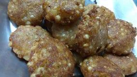 Sabudana Wada. A closeup click of potato based fresh and fried Sabudana wada snack in a pan royalty free stock photography