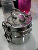 A tiffin still. A closeup click of a stainless steel tiffin lunch box stock photos