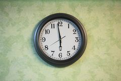 Closeup of clock. On the old wall royalty free stock image