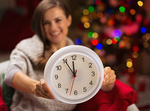 Closeup on clock in hand of happy woman Royalty Free Stock Image