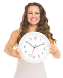 Closeup on clock in hand of smiling young woman Royalty Free Stock Image