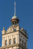 Closeup of clock tower at Dunedin railway station, New Zealand. Royalty Free Stock Photo