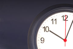 Closeup of clock on a wall Stock Photography