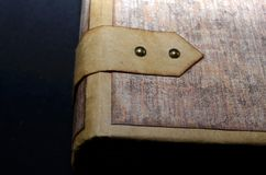 Closeup of a closing element on a cover of handmade ancient-looking photoalbum.  Stock Photo