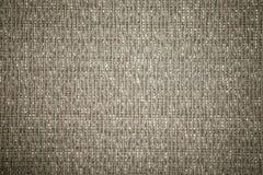 Closeup of a cloth texture background. Closeup of a brown cloth texture background stock photography