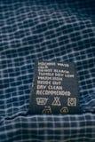 Closeup clothes label Stock Photos
