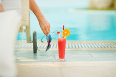 Closeup on cocktail near chaise-longue stock photography
