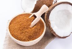 Coconut with coconut sugar  on white background. Royalty Free Stock Photography