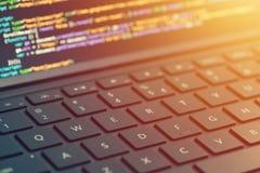 Closeup coding on screen, hands coding html and programming on screen laptop, web development, developer.  stock photo