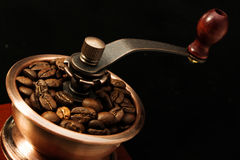 Closeup coffee bean and coffee grinder Royalty Free Stock Photo