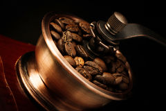 Closeup coffee bean and coffee grinder Stock Photos