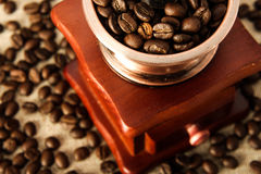 Closeup coffee bean and coffee grinder Royalty Free Stock Photography