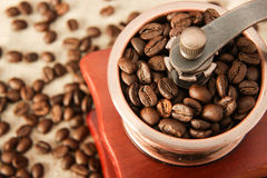 Closeup coffee bean and coffee grinder Royalty Free Stock Image