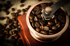 Closeup coffee bean and coffee grinder Stock Photography