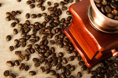Closeup coffee bean and coffee grinder Stock Images