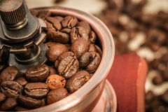 Closeup coffee bean and coffee grinder Stock Image