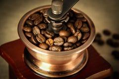 Closeup coffee bean and coffee grinder Stock Photo