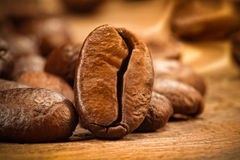 Closeup of a coffee bean on wood Royalty Free Stock Photos