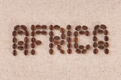 Closeup of coffee beans forming the word Africa Stock Photos