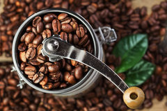 Closeup coffee beans with green leaf Royalty Free Stock Photos