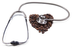 Closeup of coffee beans with stethoscope Stock Images
