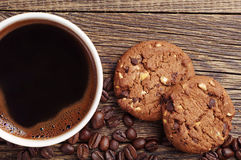 Closeup coffee and chocolate cookies Royalty Free Stock Images