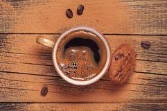 Closeup coffee and chocolate cookies Stock Photos